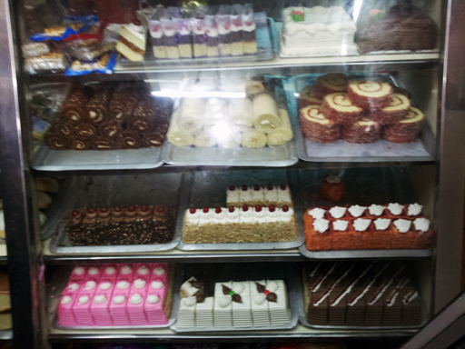A typical Indian bakery shelf with a whole range of baked goodies.