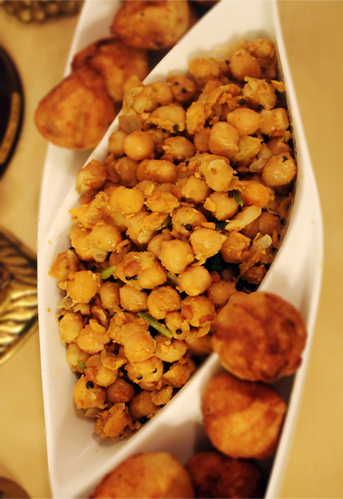 Chickpeas stir fry with coriander seeds and tempered with Indian condiments. It is a distant cousin of hummus. More on this in October.